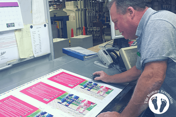 press operator inspecting the cover for quality